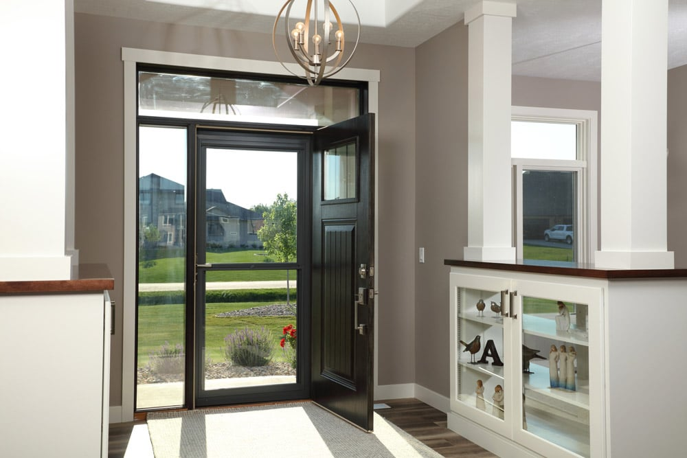 View of a black Larson brand storm door from interior of a home